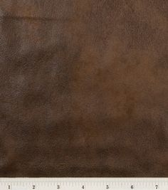 Fabric - Brown distressed foil microsuede. $16.99/yd.  58'' Wide. 100% Polyester. Handwash Separately, No Bleach, Line Dry, Do Not Iron, Do Not Dry Clean. Made in South Korea.  (Source: JoAnn.com.)