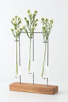 These suspended vases from anthropologie may have me getting crafty... Love!