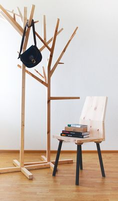 Tree shaped coathangers and Tomorrow's Classic chair I designed & made. Made from reclaimed wood.
