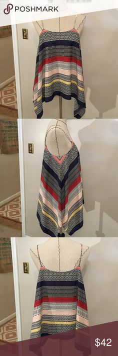 Vince Camuto Flowy Top Beautiful and unique print fabric. Asymmetrical hem and spaghetti straps. Feels like silk but it's 100% polyester. Black shell lining underneath. Colors are royal blue, black, red, yellow, pale pink, and white. Never worn!! Vince Camuto Tops Tank Tops