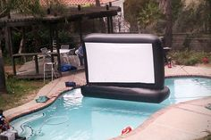 Inflatable Backyard Movie Screen - Pool parties are some of the best parts about enjoying the warm, summer season, and this ultra cool inflatable backyard movie screen is offering up. My Pool, Swimming Pools Backyard, Pool Fun, Swimming Pool Toys, Backyard Movie Screen, Inflatable Movie Screen, Pool Movie, Piscine Diy, Pool Accessories