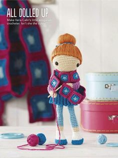Too cute - love the big scarf in background that matches dolly's