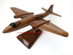 "A beautiful hand carved desktop model of the B2 Canberra. The model has been carved from solid mahogany. The model comes boxed and is simple to assemble. The wings, tail fins and stand simply slot into pre-drilled holes on the body of the aircraft. No glue required. Size H 6.5"", L 15"", W 16"". Visit our website at http://www.thewoodenmodelcompany.co.uk to view the full range of our models."
