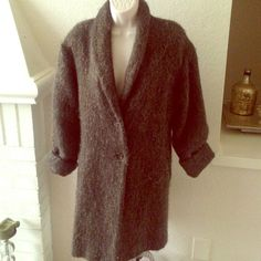 """One-of-a-kind European overcoat Strait from Europe. This coat is green/grey color with a green liner. Two front side pockets and two buttons. It's got a hair/fuzzy/tinsel like look to it. Can't really explain well. Hope my picture are good enough. Let me know if you want more it's raining today so my light isn't the best. It has no tags but it's an xl. Shoulders are measured at 18"""". Bought it big to go over cold weather clothing. You won't find another one like this. Jackets & Coats"""