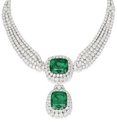 Emerald and diamond necklace, by Cartier. This piece features two large emeralds (44.42 and 42.50 carats) surrounded by 75 carats of diamonds.Via Diamonds in the Library.