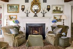 The Living Room - Charming Mountain Cottage - Southernliving. A symmetrical display of artwork surrounds an antique gilded mirror. Painted furniture and upholstery in mossy tones mimic the colors that can be found in the surrounding landscape.    Love it? Get it!Wall paint: Edgecomb Gray (HC-173)