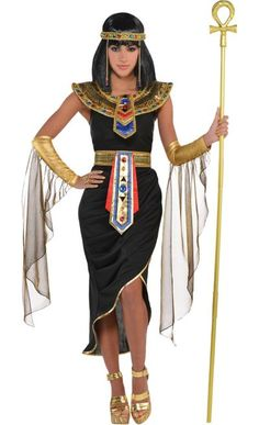 Rule your kingdom in a sexy Cleopatra costume. This Egyptian Queen Cleopatra Costume includes a black dress, a headpiece, a collar, draped arm warmers, and a belt. Egyptian Goddess Costume, Cleopatra Halloween, Cleopatra Fancy Dress, Halloween Costume Shop, Halloween Fancy Dress, Halloween Parties, Adult Costumes, Costumes For Women, Medieval Clothing