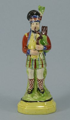 Staffordshire Pottery figure of a Scotsman playing the bagpipes
