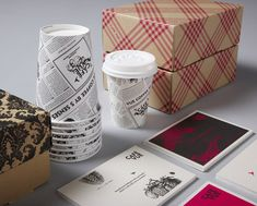 """Designed by Designworks   Country: Australia """"Designworks has had the privilege of helping develop the growing Vue de Monde family of brands, extending from the initial restaurant's humble beginnings seven years ago, through a series of successful culinary based enterprises including their three cafe's. Designworks were set the brief to develop a distinct Cafe Vue identity and eyecatching packaging that sat within the current Vue de Monde family. By referencing a french modern chic aesthetic, the new brand needed to compliment the cafe's new location, architecture and interior finishings. The result was a Marie Antoinette inspired neon pink pattern with decorative elements. Bespoke menus and Cafe Vue lunch boxes were created in a similar style."""""""