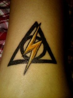 If I ever have the nerve to actually get a Deathly Hallows tattoo, this might be the way to go!