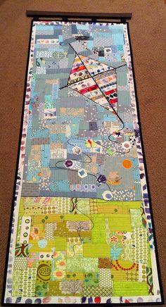Inspiration - selvage blocks kite?  love that this includes fabrics printed by kids  Kite auction quilt by lolablueocean,