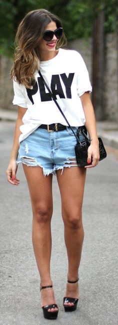 Gorgeous denim casual stylish short skirt with top white tee and black leather cute hand bag and black ladies high heels pumps and black lea...