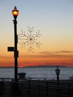 Christmas Decorations at Sunset, Huntington Beach Pier, California California Love, California Travel, Southern California, Huntington Beach Pier, Surf City, Street Lamp, Sunset Photos, Places To See, Beautiful Places
