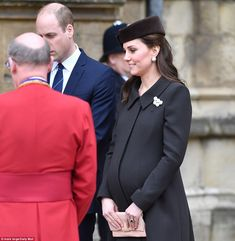 Bump's the word! Kate, 36, looked comfortable on a cold day dressed in a smart chocolate-brown coat with matching velour pillbox hat and caramel-coloured heels as she chatted with the Dean of Windsor at St George's Chapel, Windsor this morning