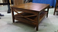 storage cocktail table with bow design ends