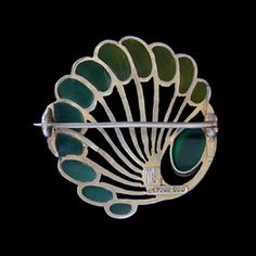 LEVINGER & BISSINGER  A gilded silver, green plique-a-jour brooch, set with a chrysoprase cabochon.  German c.1900. Maker's mark '900' and 'DEPOSE'. Size: Diameter 3.3 cm. Sold by Van Den Bosch. View 2.