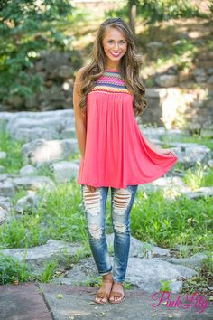 Get your little piece of aztec with this new tank! It's a coral top with an aztec style print in red, yellow, green, pink, purple, and sky blue for a standout pattern.