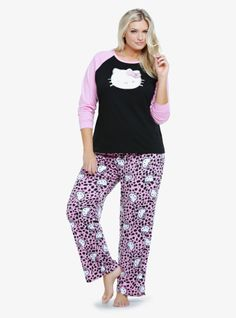 This adorable Hello Kitty sleep set includes a black and pink raglan top and pink leopard-spotted fleece sleep pants. It arrives all bundled up with a Hello Kitty-themed ribbon - check this one off your holiday gift lists.