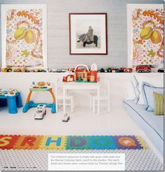 Stylish kids playroom by designer Hillary Thomas. Love the artwork, white flooring, and gray wallcovering best.