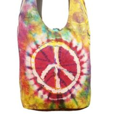 This bag has a peace symbol and is spacious. The shoulder strap is roomy. There is a small zipper pocket in the main compartment.