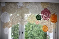 This is a beautiful way to filter light without blocking it completely– a DIY windowshade made of doilies. I always spot mismatched stashes of them in thriftstores. Collect your favorites and stitch...