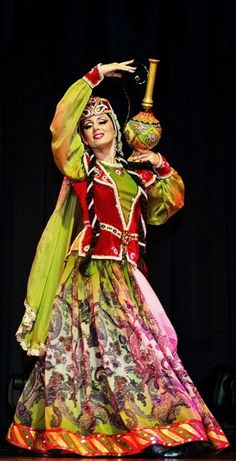 A dancer in traditional festive costume, from Azerbaijan.  Clothing style: early 20th century.