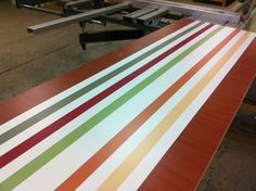 Counter frontage panel using 7 different laminates from Polyrey.