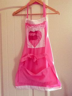 Patchwork heart girls apron hand sewn by Creative Hands #apron #sewing #girl #patchwork #pink