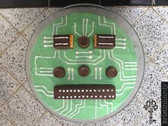 Circuit board themed cake made with chocolate covered wafers, rolos, and white lettering icing.  #cake #birthday #computer #nerd