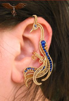 Golden peacock ear cuff by RockTime on Etsy