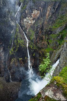 Vøringsfossen in Måbødalen, Hordaland county is Norway's most famous waterfall, and has a fall of 182 metres, of which 145 metres is a direct drop. Vøringsfossen dazzles tourists with its multiple waterfalls all converging at the head of Måbødalen in Hardanger. http://www.hardangerfjord.com/en/Eidfjord/Product/?TLp=449090&Voringsfossen-Mabodalen=