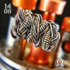 That kung fu grip   originally by @vape_and_pillage. This is a big boy and barely fits under the cap wrapped on 2.4mm. Specs: 2x 32ka1/ 40n60 claptons twisted and helixed with 2x32ka1 , 32ka1/40n60 fused clapton, 3x 32ka1 twisted then wrapped with 30ka1 c