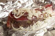 While foil-packet cooking is most often done during camping, it's also a convenient way to cook lean cuts of steak in the oven. Wrapped in foil, the steak essentially cooks in its own steam, ensuring that moisture stays in the meat. You can also turn it into a single-serve meal by adding vegetables to steam cook in the packet along with the steak.