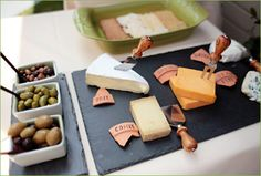 cheese & olive platter beautifully set against a dark slate platter with broken pieces of terracotta to label assorted cheeses Backyard Birthday Parties, Slate Cheese Board, French Cheese, French Cafe, Cheese Platters, Food Labels, Yummy Food, Snacks, Clothing Swap