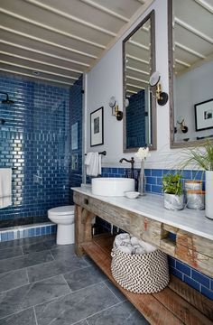Rustic decor, royal blue subway tile shower, and blue stone floor in a modern country style bathroom by Sarah Richardson. Vanity from Salvaged wood beams Country Style Bathrooms, Modern Country Style, Rustic Modern, Rustic Style, Coastal Style, Blue Subway Tile, Subway Tile Showers, Rustic Bathroom Vanities, Small Bathroom