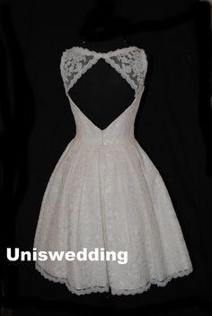 Above knee length open back short lace wedding dress on Etsy, $188.00