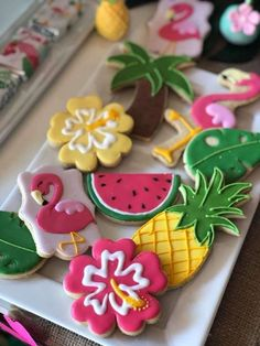 Loving the tropical mix of cookies at this Flamingo birthday party!! See more party ideas and share yours at CatchMyParty.com #catchmyparty #flamingo #cookies #partyfood #flamingobirthdayparty #summerparty #summerbirthdayparty #tropicalparty #flamingocookies #partyideas #summer