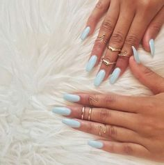 Just because your nails are ultra-long doesn't mean they have to be dramatic. This soft pastel blue shade keeps the manicure subtle and perfect for stacking delicate rings. These coffin nails are perfect...just in time for our Halloween mani!