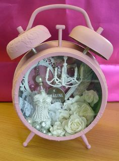 Altered clock ... personally think this is tacky, but I like the concept ... would work for a dollhouse scene