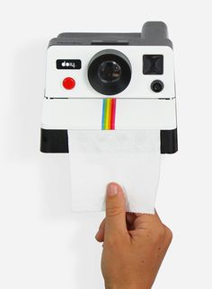 Black Polaroll Toilet Paper Holder by Doiy. Quirky, retro, and perfect for adding some humor to your porcelain throne room.This toilet holder resembles an old-school polaroid camera and dispenses the toilet paper like the actual camera! http://zocko.it/PD0y