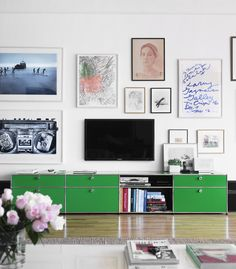perfect tv placement in an art wall. Repinned by Secret Design Studio, Melbourne.  www.secretdesignstudio.com