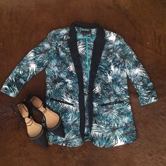 Tropical palm print tuxedo blazer shoulder pads This fun polyester blazer is perfect for bringing a little vacation spirit to your wardrobe after the sun goes down. Worn with chic shoes, it instantly dresses up boyfriend jeans and a tank for a night on the town. Black, white, deep navy and teal palm print. Unlined interior features shoulder pads for additional structure. Details include decorative front pockets and slightly ruched 3/4 sleeves to mimic a carefree sleeve roll. Jackets & Coats…