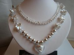SnowFlakes On Ice Three Strand Necklace Stunning Freshwater Pearls, Sterling silver Beads, Swarvoski Crystals, Glass Heart inset sterling silver , Sterling silver Three Strand Clasp . Designed &Handmade By Ann Cunningham (Showoffjewels)