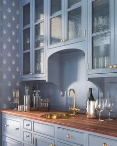 Blue butler& pantry features blue cabinets, upper cabinets accented with seeded glass cabinet doors, adorned with brass knobs paired with wood countertops fitted with a round brass sink and gold vintage style faucet. Kitchen Remodel, Butler Pantry, Kitchen Design, Kitchen Dining Room, Glass Cabinet Doors, Home Decor Kitchen, Wood Countertops, Home Decor, House Interior