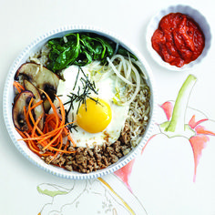 Try our  Bibimbap recipe with warm brown rice topped with sautéed veggies, turkey and an all-important fried egg. Find more recipes at Chatelaine.com.