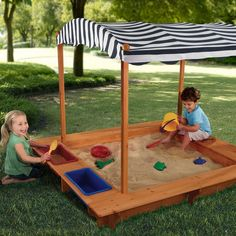 Outdoor Sandbox With Blue Striped Canopy