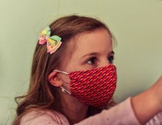 With the lockdown restrictions loosening from today, are you certain that your family is prepared? Wearing a mask is one of the most effective ways to stay safe when outside of your home.   Stella is wearing the pink and yellow mini shweshwe barrier mask here. You can get your kiddie's mask too! Mask For Kids, Stay Safe, Masks, Action, Colours, Yellow, Mini, Fabric, Earrings