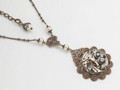 Steampunk necklace silver watch movement gears gold filigree flower pearl Swarovski crystal pendant jewelry  #SteampunkNecklace #SteampunkJewelry #SteampunkJewelrybyMariaSparks