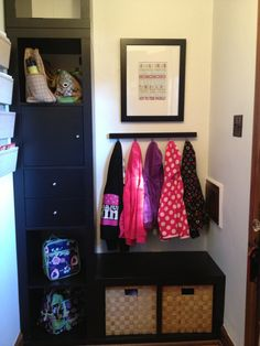 #entryway #storage #mudroom I love this entryway storage idea.  A place to sit, hang your coat and a landing pad for backpacks.  Just what the organized home needs.