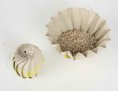 Sunflower seed packaging designed like a sunflower. I would love to reuse this little bag for day-time snacks